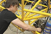 Student working on an engine